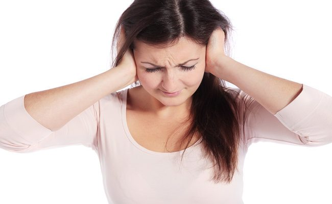 ear infection pain hands over ears